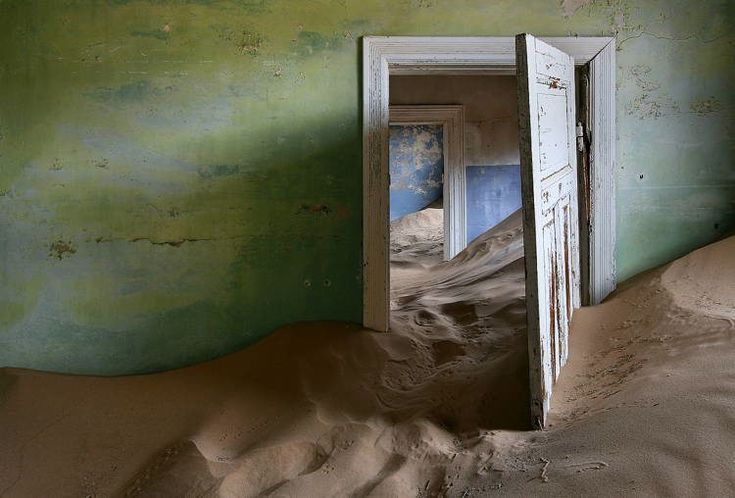 Kolmanskop, Namibia. The sand-ridden city's roots date back to 1908, when a black worker discovered the site's abundance of diamonds and alerted his superior. Westerns seeking more wealth soon exploited the area's resources, propping up Western-style towns in the process but making sure to get out of town when the well ran dry. Material pleasures, however, proved finite when the diamond field was exhausted and people began to abandon it.