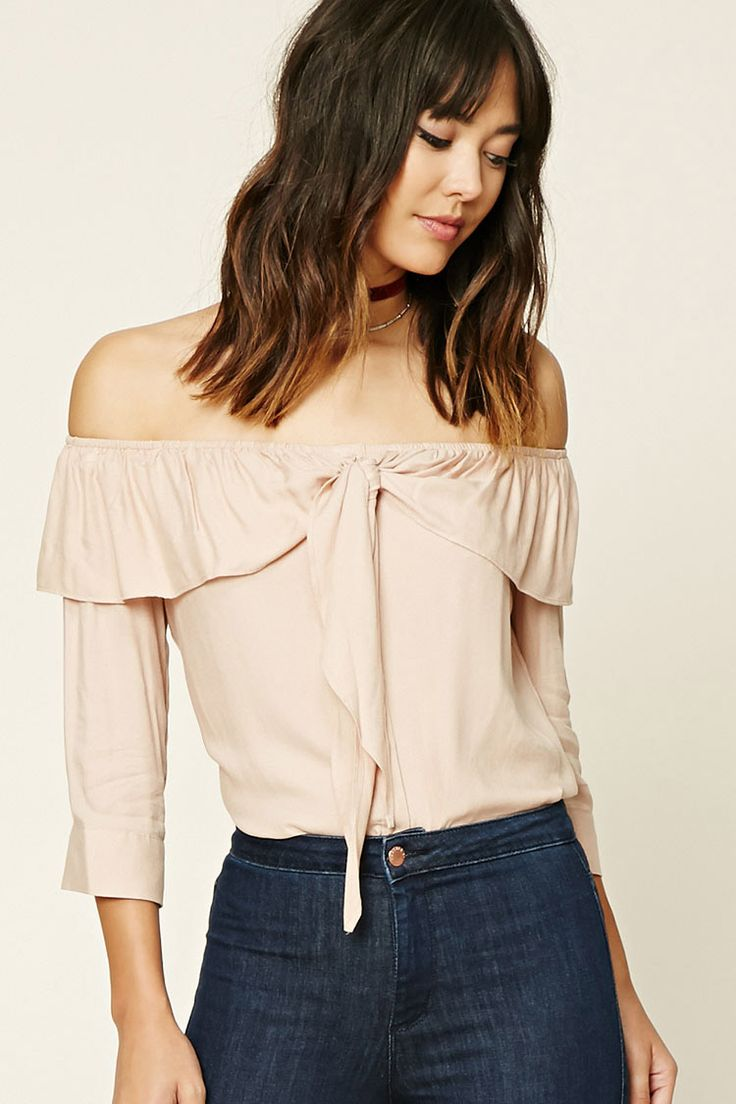 Forever 21 Contemporary - A woven shirt featuring an elasticized off-the-shoulder neckline with a flounce detail that ties in the front, 3/4 sleeves with buttoned cuffs, a button- down front, and a curved hem.