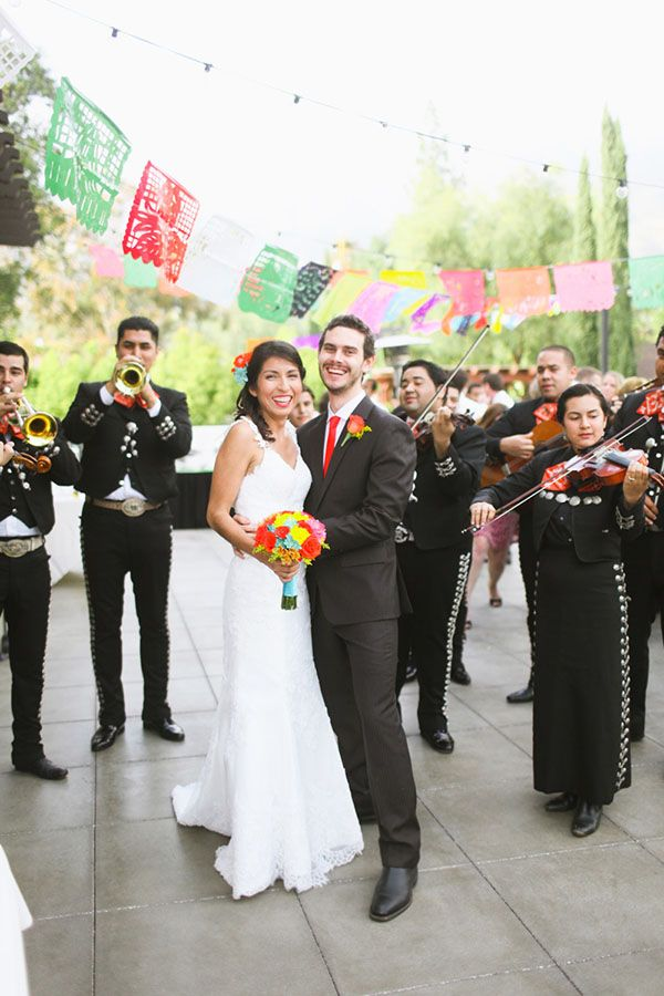 Love the band and flags at this mexican themed wedding