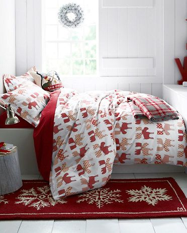 Add a touch of whimsy this holiday season with festive flannel sheets and a hooked wool rug in a snowflake motif.