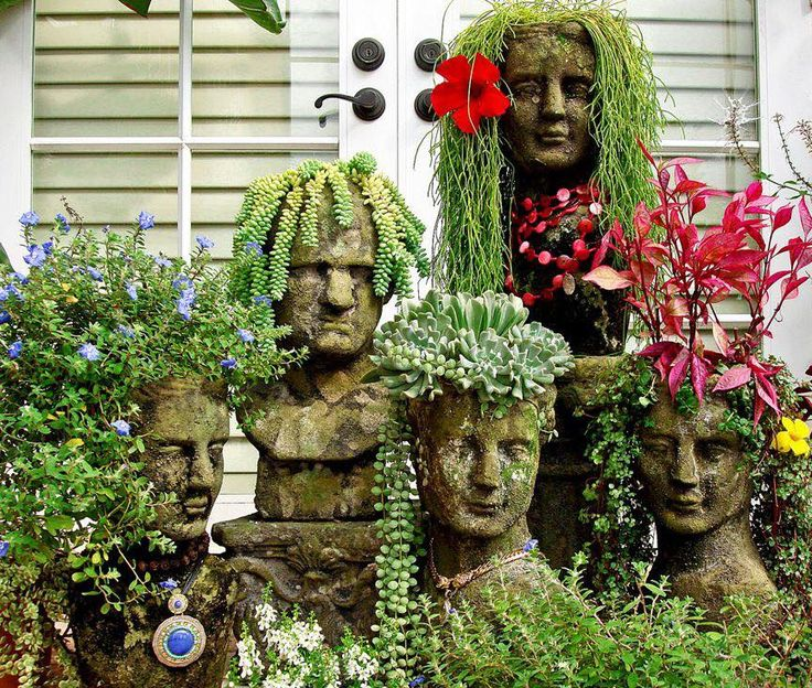 These Cement Head Planters are easy and inexpensive to make and will look fantastic around your garden.