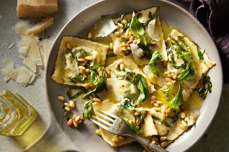 Make a batch of pasta then stuff with a simple filling and top with basil, pine nuts and parmesan for tasty, pillowy parcels.