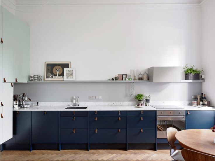 Navy blue kitchen cupboards with leather handles via Entrance Makleri.se   10 Beautiful Rooms - Mad About The House