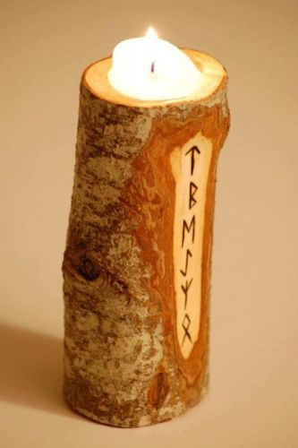 DIY- Rune candle holder made from a branch or sapling trunk.
