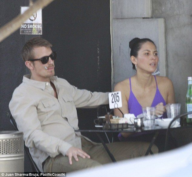 Nicotine fix: Olivia Munn's boyfriend Joel Kinnaman smokes an e-cigarette while dining alfresco at Joan's On Third in West Hollywood on Saturday