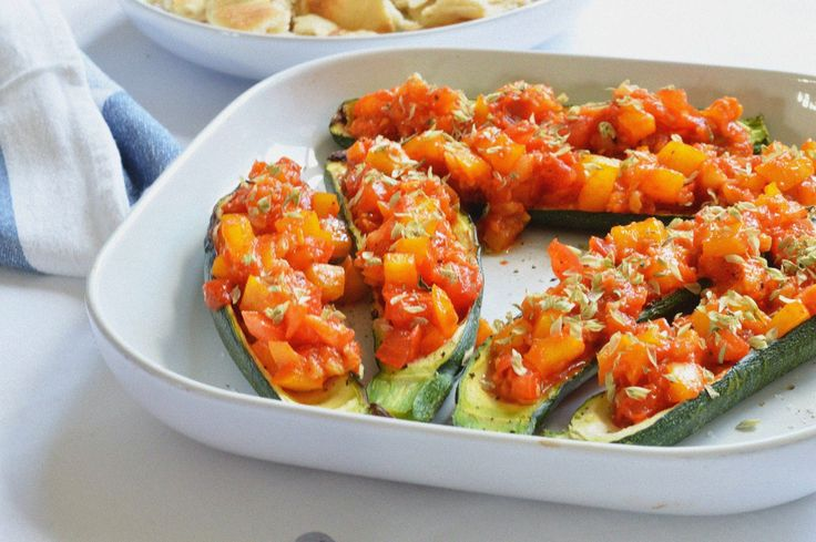 stuffed courgette with tomato and peppers.