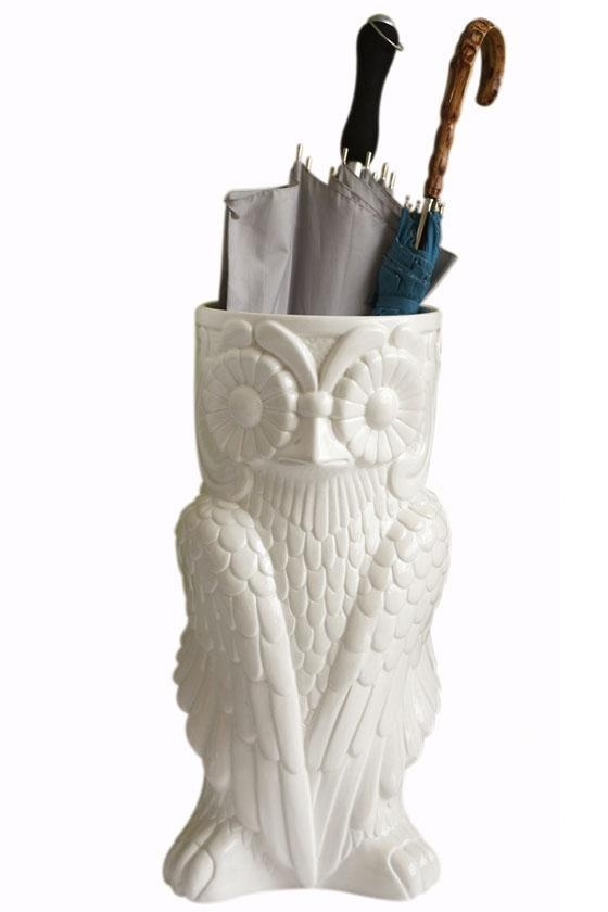 owl umbrella stand.  the only chance my umbrellas have of ever ending up where they belong.