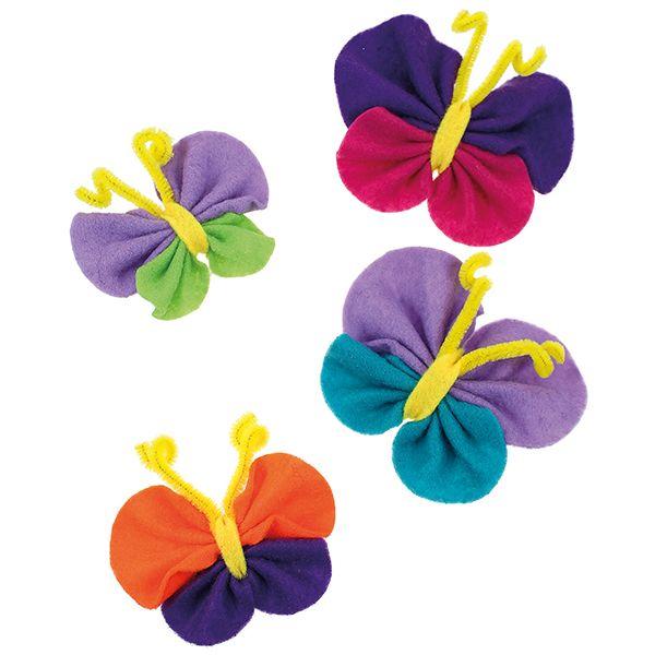 Huopaympyröistä valmistetut helpot perhoset. Ripusta roikkumaan tai kiinnitä magneetti perhosen taakse.