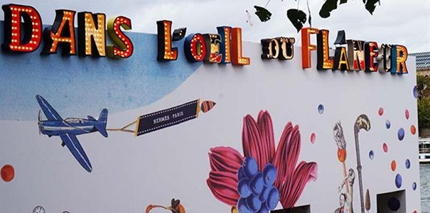 De driedimensionale voorstelling van het Franse designhuis Hermès heeft een festival-achtige flair en omringt bezoekers met Parijse chic.