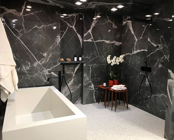 Marble-effect porcelain extra large format tile slabs as seen in a bathroom setting at Cersaie 2017.