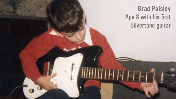 """Brad Paisley Age 8 With his first Silvertone Guitar. """"My life as I know it began on a Christmas morning when my grandfather said 'I want you to have this' and he gave me his old Silvertone Guitar."""""""