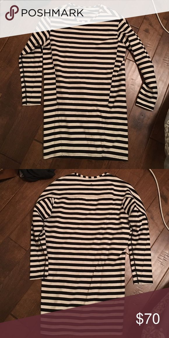 Size 4 lululemon dress great condition Size 4 lululemon dress great condition black and white stripped thicker material lululemon athletica Dresses Long Sleeve