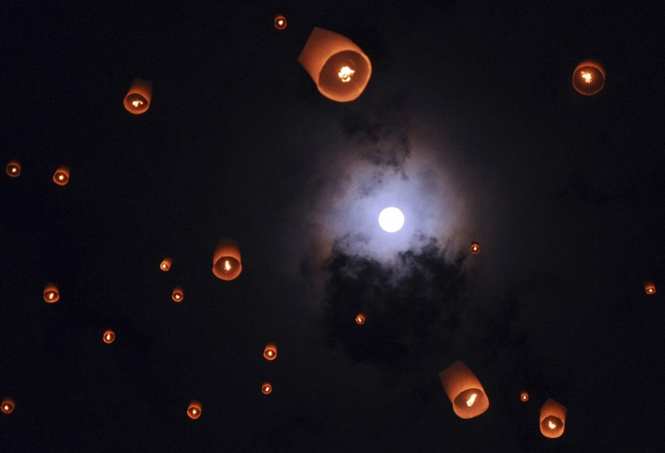 Lanterns release by Buddhist worshipers fly during a procession commemorating Waisak day which marks the birth, death and enlightenment of Buddha at the 9th century Borobudur temple in Magelang, Central Java, Indonesia.