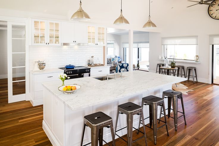 "Industrial design is all about combining utility pieces with natural surfaces to create an overall softer contrasting look. Here the designer has combined heavy industrial bar stools and lighting with marble benchtops, brickwork splashbacks, natural timber flooring and satin white cabinetry. The overall effect is stunning. What do you think of our industrial design kitchen? Door profile: ""Sheree"" in Satin White available only at Albedor. For more information visit www.albedor.com.au"
