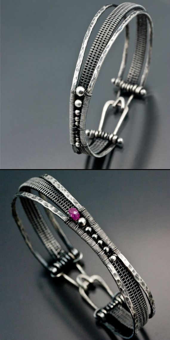 Woven Orbit Bracelet - Added to the woven band are 2 hammered wires woven together off to the side to create an asymmetrical bracelet. Nestled in the nexus of the 2 wires are sterling silver beads and 2 Black Melanite Garnets. Sarah Thompson