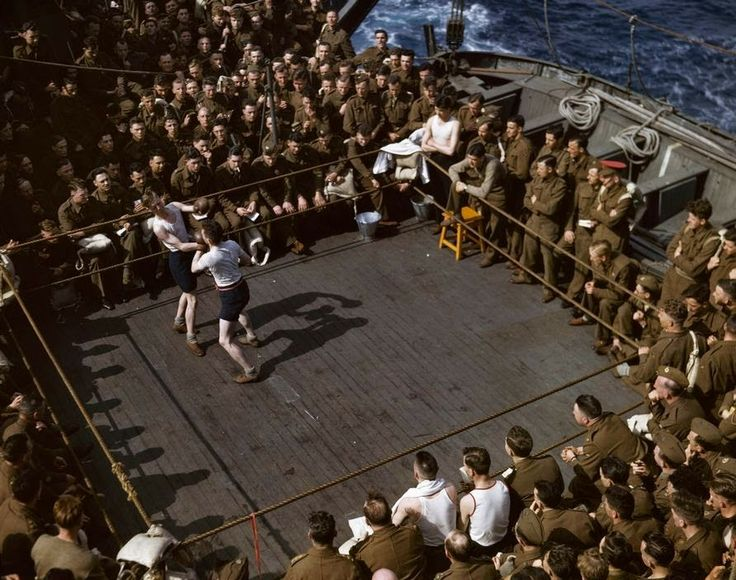 vintage everyday: British soldiers watching a boxing match on a troop ship, ca. 1943