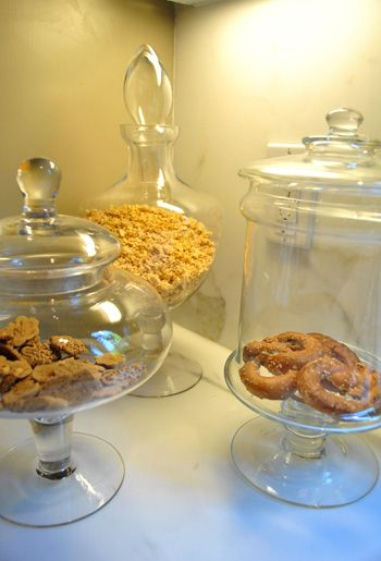 Apothecary jars under the shelves