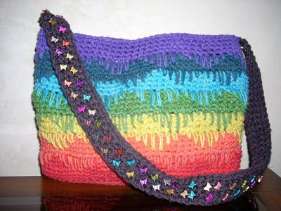 Umme Yusuf: Rainbow Spikes Bag Not crazy about the rainbow colors but with three subtle choices would be great.