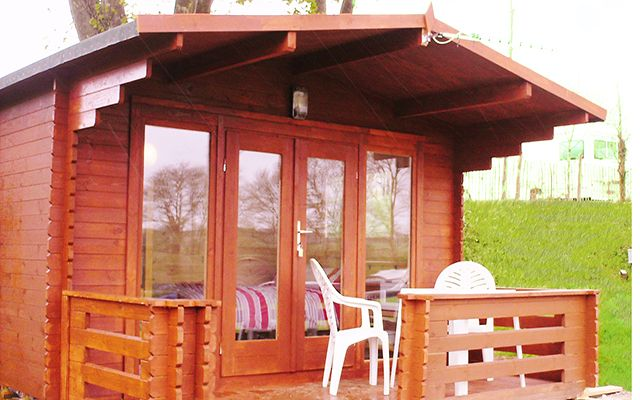 Cosy Cabins bookings from Friday 2nd May until the end of our season for these cabins 3rd November.  Our cosy cabins sleep up to four people (ideally 2 adults and 2 children) with a double bed and a set of bunk beds.  The cabins are built using solid pine logs with double glazed opening windows and lockable patio doors.  Fully insulated to keep you warm in those cooler months and cool in the warmer months.