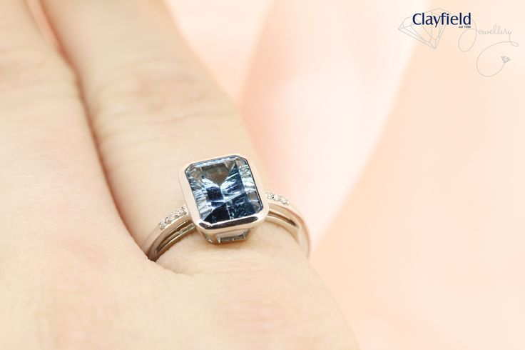 Blue topaz ring with diamond inset band, by Clayfield Jewellery in Nundah Village, North Brisbane.