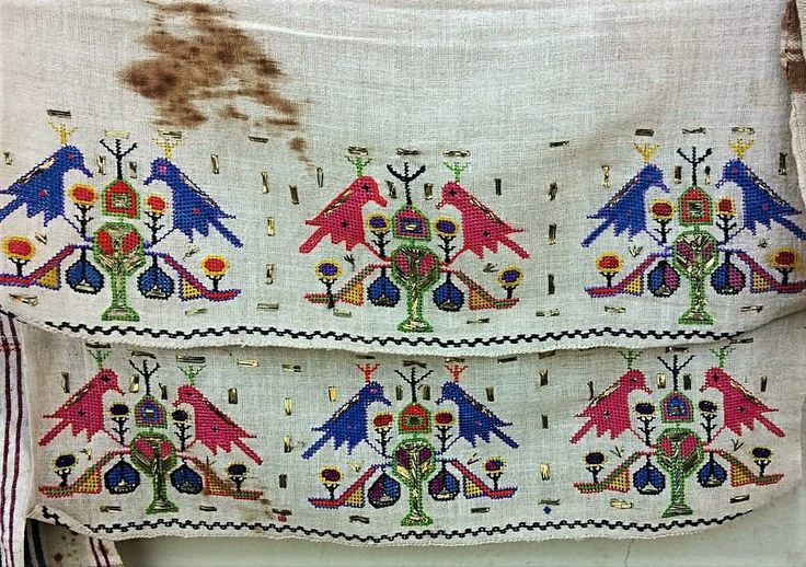 19th century embroidered 'yağlık' (large handkerchief, traditionally often worn on the waist belt).  From northwestern Anatolia.  With a 'kuş' (bird) motif.  'Two-sided' silk embroidery on linen, with small spots of 'telkırma' (metallic slats).   (Ismail Antik, Bursa).