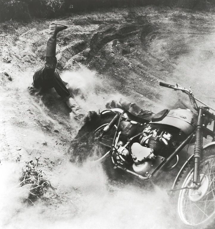 World Press Photo of the Year - Winner 1955 - A competitor tumbles off his motorcycle during the Motorcross World Championship at the Volk Mølle race course. (Mogens von Haven)