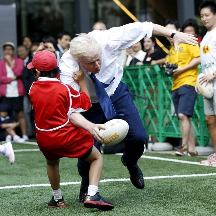 London mayor Boris Johnson has knocked over a ten-year-old boy during a game of touch rugby in Tokyo.