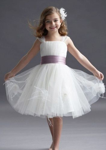 White sheer flower girl dress with big white flower...LOVE! she looks so pretty, elegant, and yet still very much her age :)