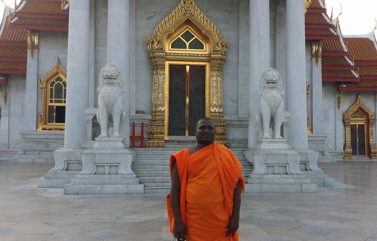 Monk outside a temple in Thailand.