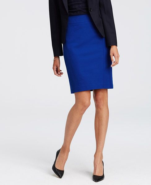 """Sleek and stretchy, our amazingly sharp pencil skirt sports contoured seaming details for figure flattering definition. Hidden back zipper with snap closure. Back vent. 22 1/2"""" long."""