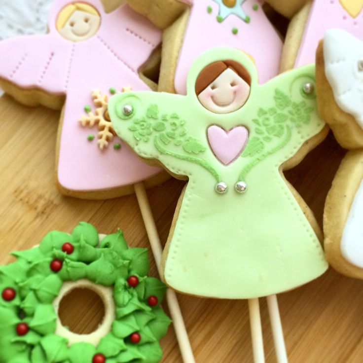 Christmas Angels - each one unique and hand crafted. #cakeintheafternoon #cookies #christmas #fondantart #cookieart  #sugarcookies #cutoutcookies #handmade #angels #christmasangel #edibleart #yum #vintage www.cakeintheafternoon.com