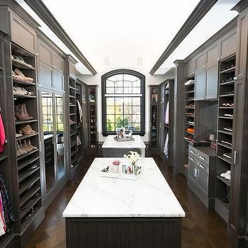 Dual Closet Islands With Honed White Marble
