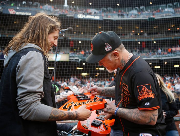 . Metallica guitarist James Hetfield signs a guitar used to play the national anthem before the San Francisco Giants play the Colorado Rockies at AT&T Park in San Francisco, Calif., on Friday, May 6, 2016. (Jim Gensheimer/Bay Area News Group)