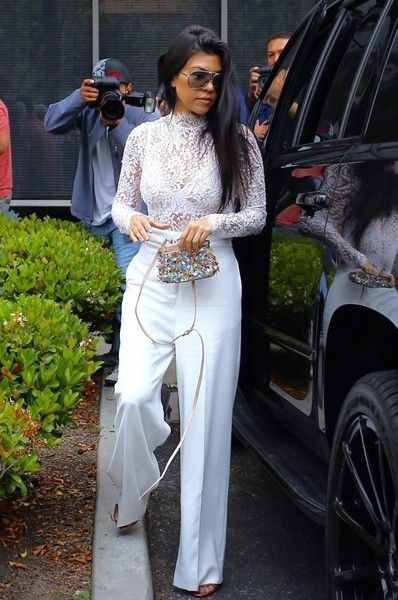 Kourtney Kardashian Bodysuit - Kourtney Kardashian went to church on Easter rocking a white lace bodysuit by Misha Collection.