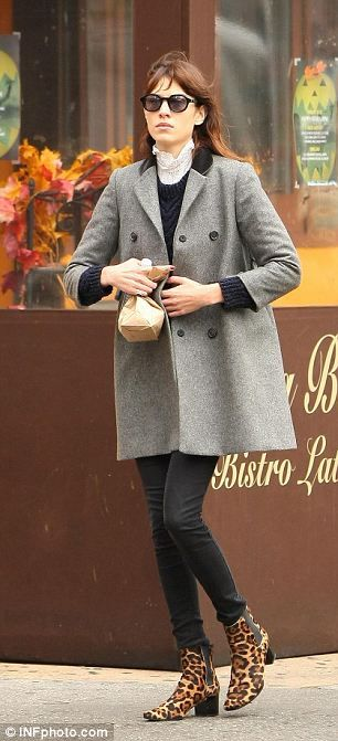 Stepping out: The model looked cosy in her coat and layered outfit