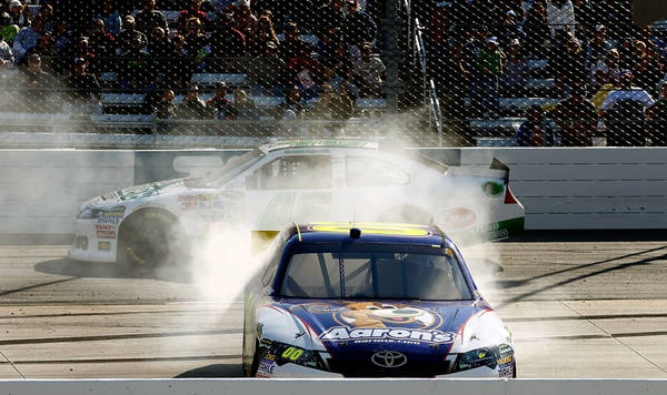 Wrong wayThat just doesn't look right. David Reutimann spins out at Martinsville, one of the many incidents during the race.    Jeff Zelevansky - Getty Images