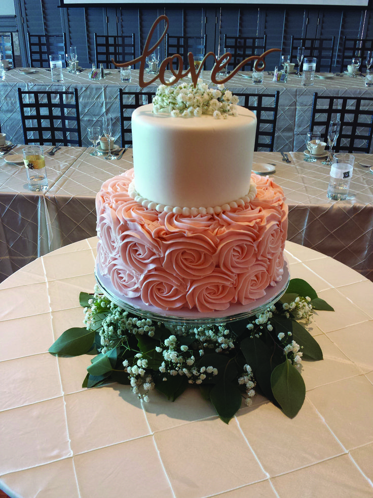 Jessa cake - two tier buttercream wedding cake with smooth top tier and pink rosette bottom tier