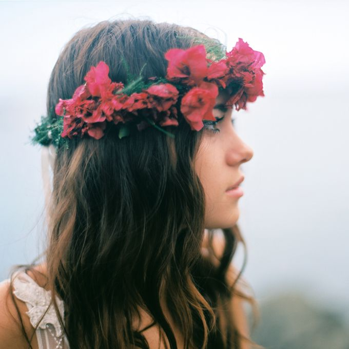 Brides: Romantic Wavy Hair with Red Flower Crown. This dark-haired bride accents her wavy locks with a statement-making red flower crown for an ethereal vibe.