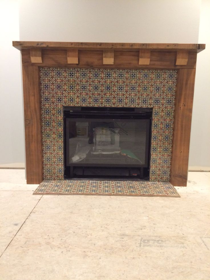 Fireplace mantle of reclaimed fir and mexican tile.