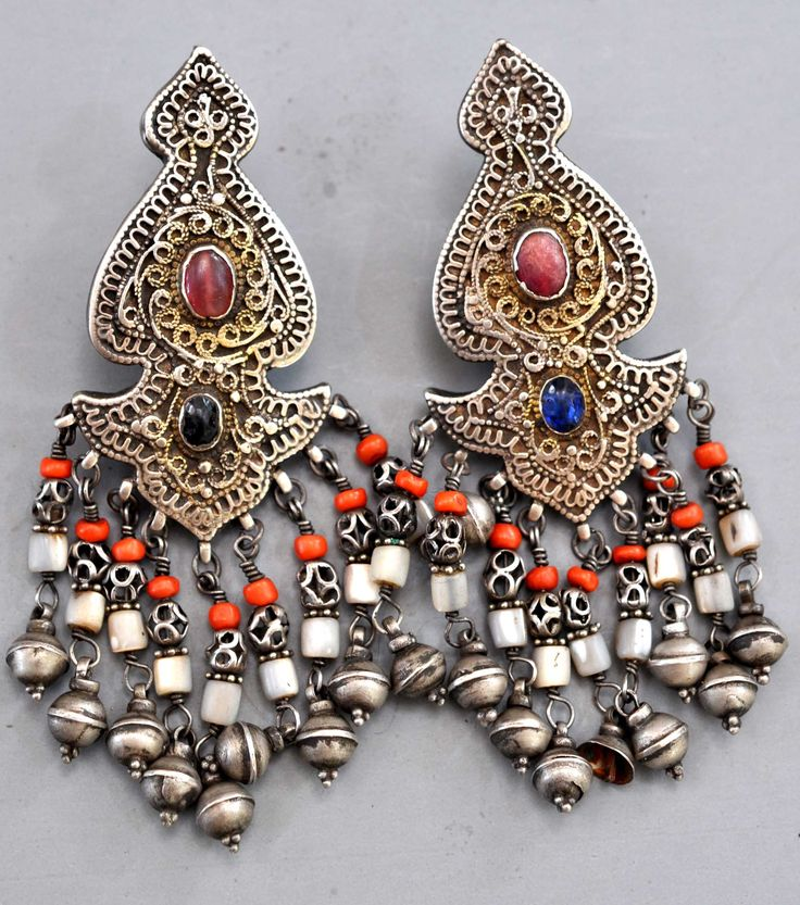Uzbekistan | Silver filigree earrings with ruby, sapphire and mother of pearl, coral beads. | Khiva area, late 19th century | Private collection Linda Pastorino