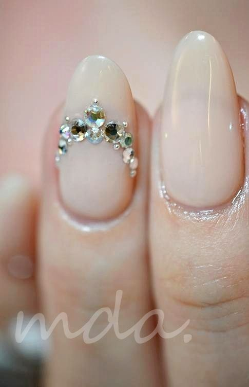 Cream stiletto with gemstones.
