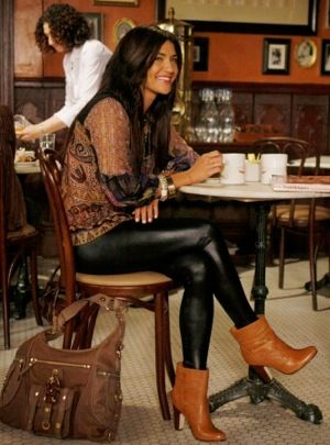 Vanessa Abrams in her favorite coffeehouse for a cup of joe wearing a saucy pair of faux-leather leggings, Nanette Lepore Paisley top, and cognac ankle booties. The juxtaposition between boho girl and rocker chick is perfect for a day of fashionable studying.