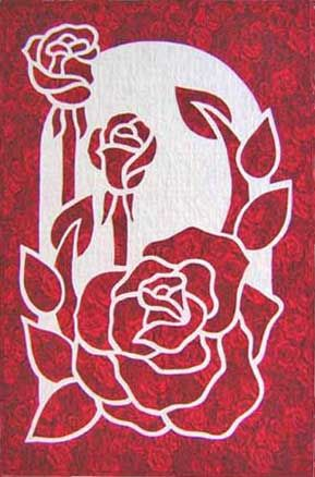Another 2-color applique.  I found red-rose printed batik for the foreground and made this for my niece Emily.