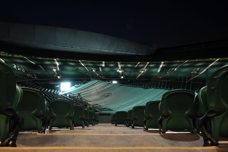 Seats in Centre Court are shown at night. - Florian Eisele/AELTC