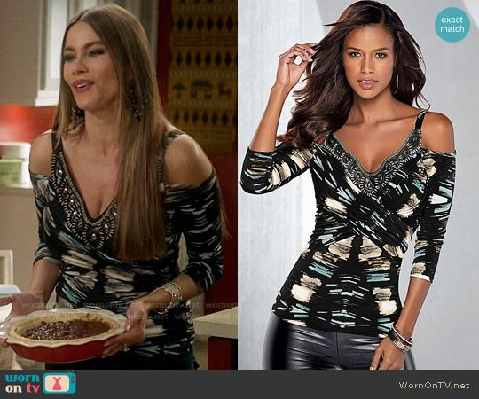 Gloria's printed cold-shoulder top with beaded trim on Modern Family.  Outfit Details: https://wornontv.net/71400/ #ModernFamily