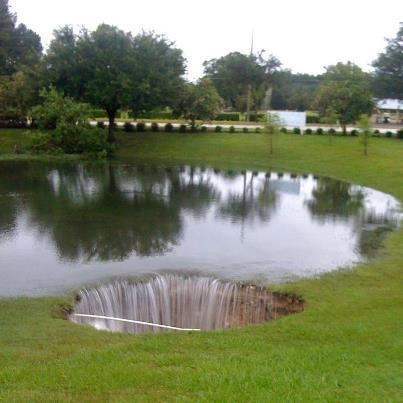 new sinkhole draining a lake formed from an old sinkhole - Live Oak, Florida