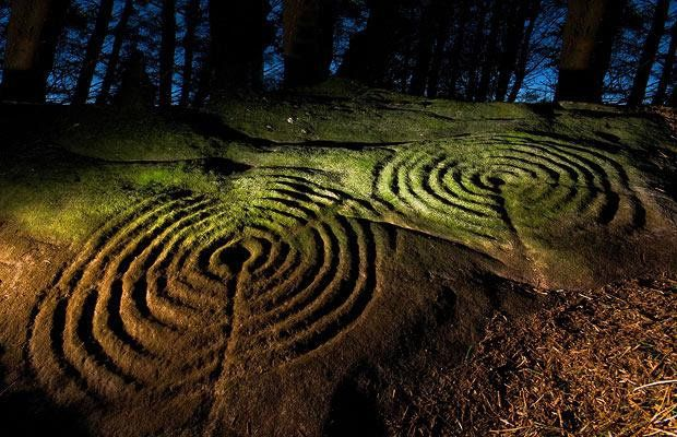 The 5,000-year-old Neolithic carvings of concentric circles, interlocking    rings and hollowed cups were uncovered as part of a four-year English    Heritage-funded initiative, in partnership with Northumberland and Durham    County Councils, to record and publish online all the prehistoric rock art    within the region