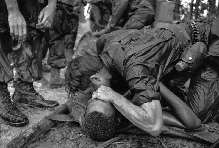 A medic of the 101st Airborne Division attempts to save the life of a fellow medic wounded during the assault against the North Vietnamese a...