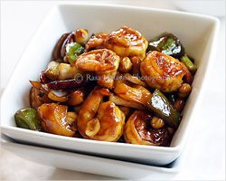 Recipe: Kung Pao Chicken (宫保鸡丁)    Ingredients:    1 1/2 boneless & skinless chicken breast (or 3 boneless & skinless chicken drumsticks)  3 tablespoons roasted peanuts  8-12 dried red chilies (deseeded and cut into halves)  3 tablespoons cooking oil  5 slices peeled fresh ginger  2 gloves garlic (sliced diagonally)  1 stalk scallion (chopped)    For the marinate:    1 tablespoon corn starch  2 teaspoons soy sauce  1 tablespoon Shaoxing wine  1 teaspoon oil    For ...