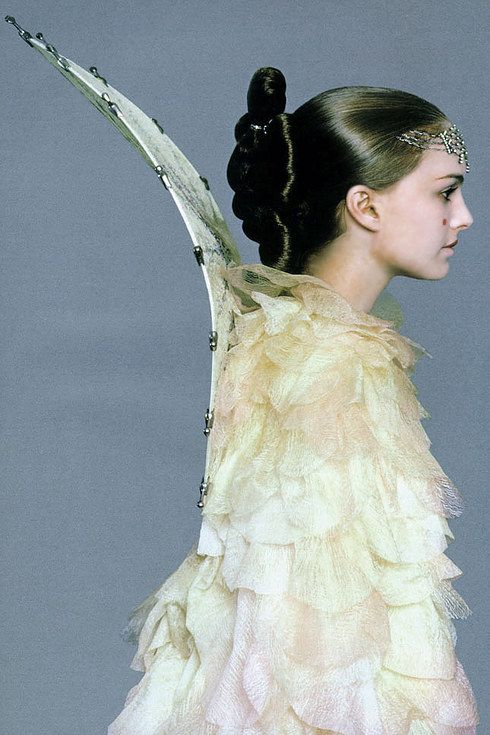 """Concept artist Iain McCaig said """"I designed a parasol-like collar that almost makes her look like an angel."""" (Dressing a Galaxy/Rebel Haven) 